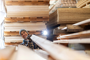 Happy employee in wood production facility
